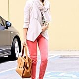 Donning punchy denim, an open French Connection jacket, and embellished suede booties, Jessica Alba created an office-ready look that does double duty as a lunch date look.