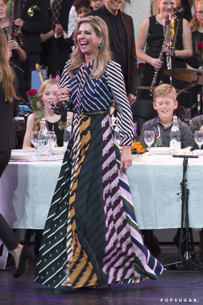 Royals love their fashion, but Argentina-born Queen Máxima's style has a Latin flair we can't help but appreciate. And her recent Mary Katrantzou number defines it all in one chic maxi dress. Fit with mixed prints and serious color blocking, it was literally impossible to ignore the Dutch royal while she was tending to her duties at Amsterdam's Carre Theatre on Dec. 9 for a holiday-themed event benefiting music in classrooms. She paired the bright, multicolor striped dress with purple drop earrings and a deep green suede clutch, tying the look together even more with touches of other colors included in the eye-catching maxi. Keep scrolling to zoom in on Máxima's striking OOTD and shop for similar styles. Then, admire even more of her stunning 2016 outfits.      Related:                                                                The Moment You See Queen Máxima's Most Daring 2016 Looks, You'll Fall Deeply in Love With Her Style                                                                   Photographic Evidence That Queen Máxima of the Netherlands's Hat Game Is Strong                                                                   All the Times Queen Máxima Was So Legitimately Excited to See Her Fans, It Showed on Her Face