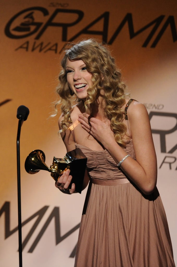 Taylor Swift celebrated her pre-telecast Grammy award in January 2010.