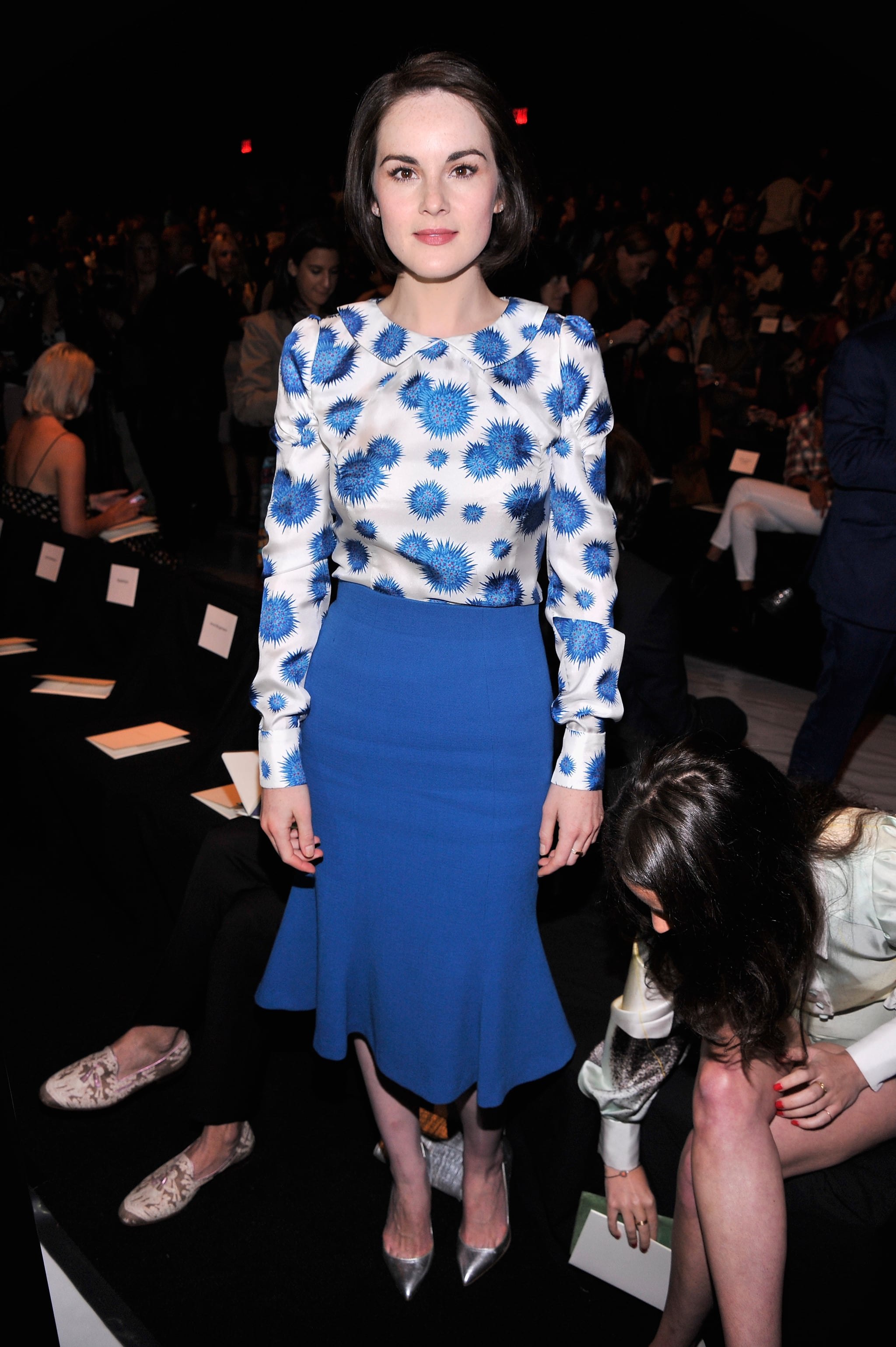 Downton Abbey star Michelle Dockery took her seat in the front row for Monday's Carolina Herrera show.