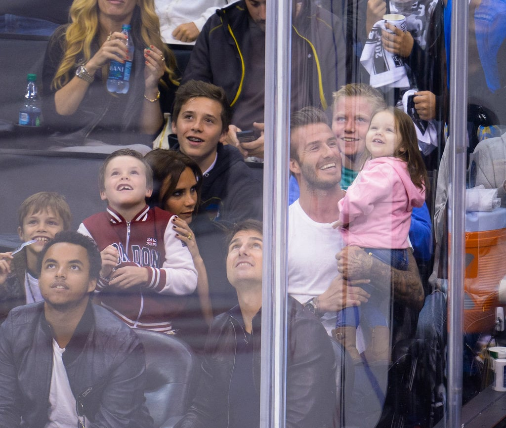 The Beckhams attended an ice hockey game in May 2013, and David and Harper got caught on the kiss cam!