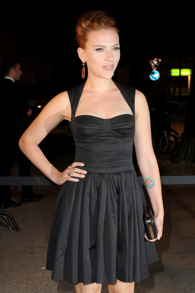 Scarlett wore a sexy black dress to dinner in Milan.