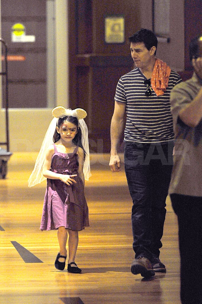 Suri Cruise wore Minnie Mouse ears with dad Tom Cruise.