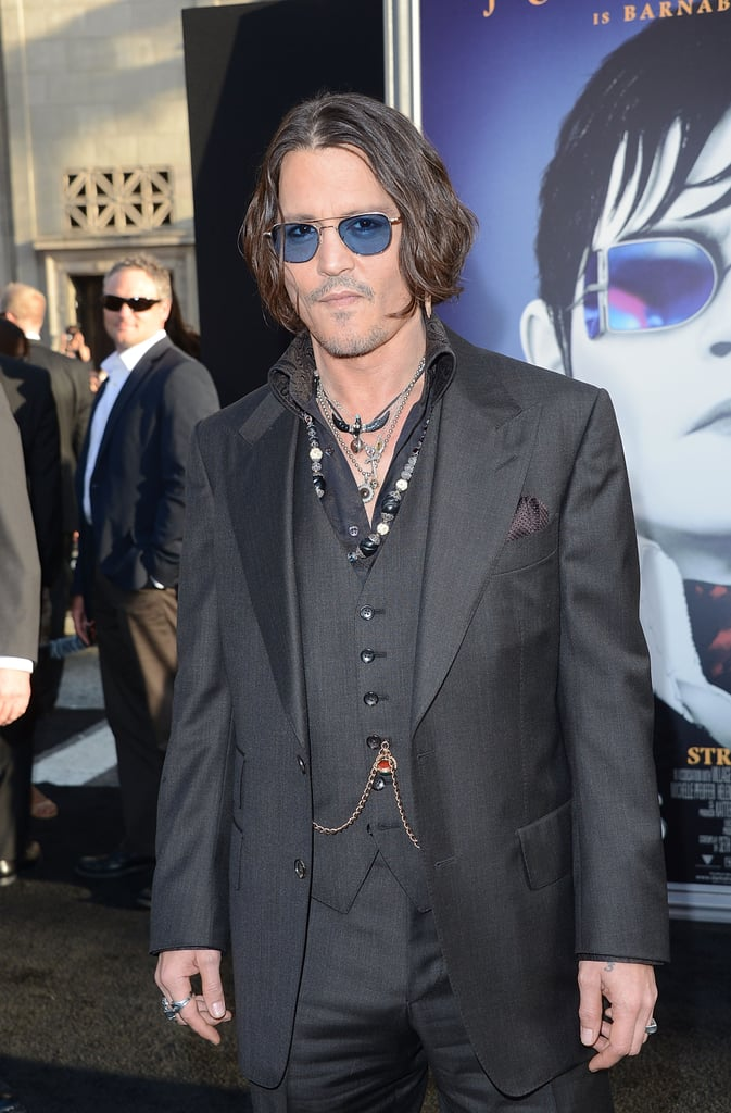 Johnny Depp wore blue shades and a black suit to the Dark Shadows premiere in LA.
