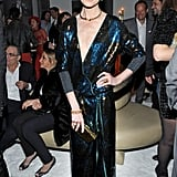 Michelle Monaghan topped off her glittering '70s-style dress with an Edie Parker clutch and Stella Luna heels at W's party.