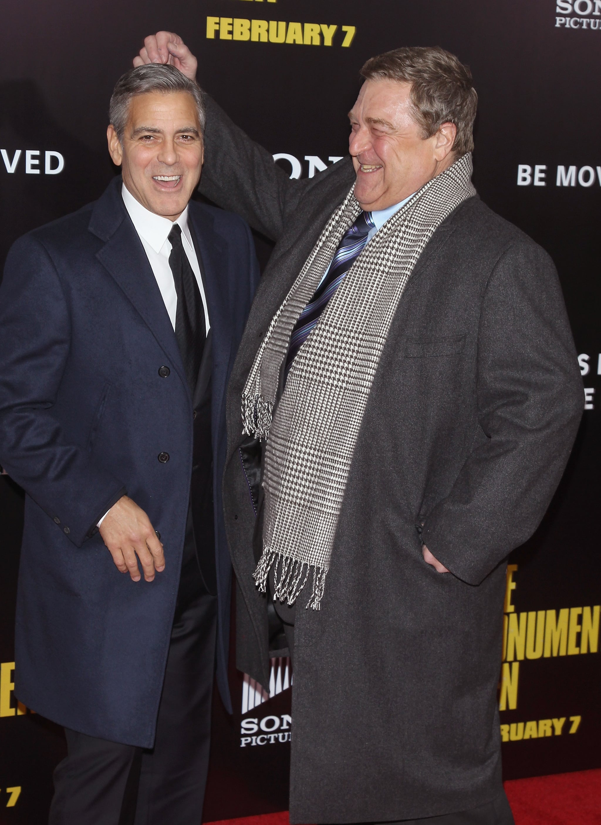 John Goodman played around with George on the carpet.