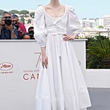 """Elle pulled out her Alexander McQueen prairie dress for The Beguiled photo call, and she grounded the cloud-like number with a pair of embellished platform sandals. The look felt breezy and natural, especially since the star swept up her hair to put her midi's details on display — bishop sleeves, ruched bodice with bows, and all."" — SW"