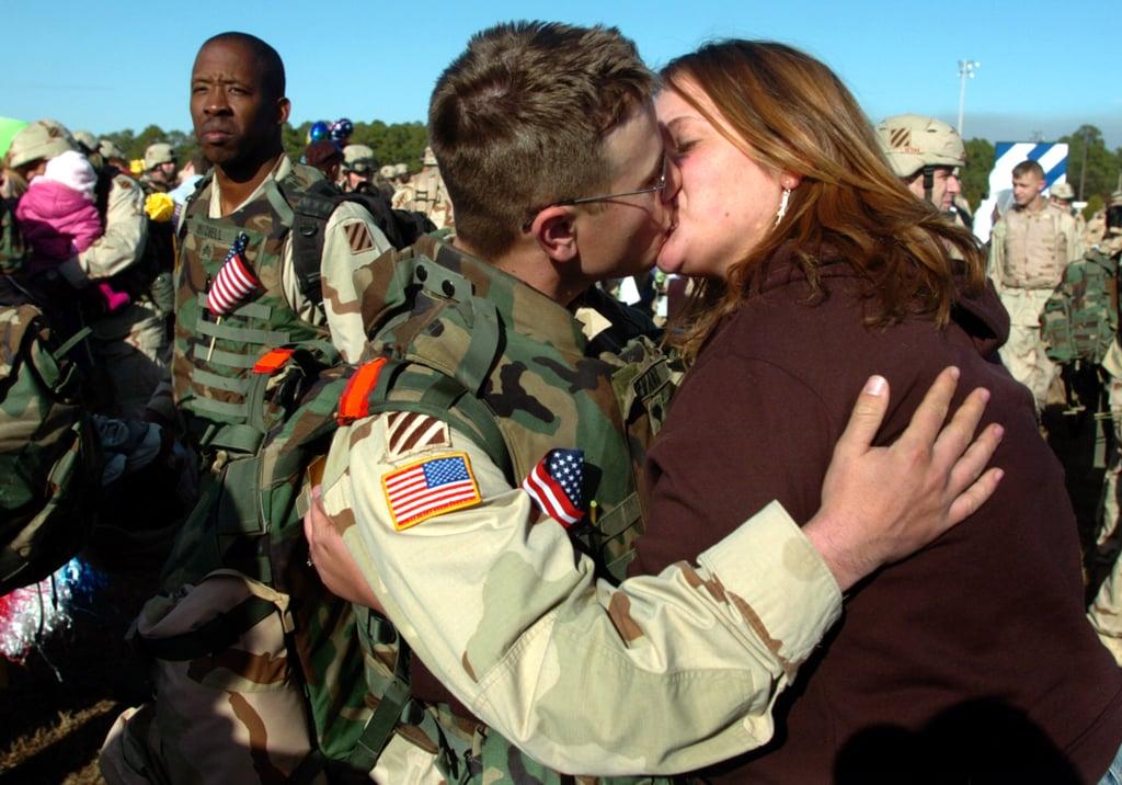 Meghan Gibson greets her fiancé, Spc. Aaron Evans, in 2006.