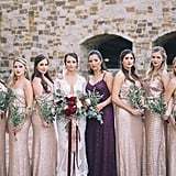 These bridesmaids stood by the bride's side in different blush dresses, while the maid of honor wore a deep purple.