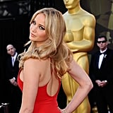Jennifer Lawrence Matches the Oscars Carpet in Red Calvin Klein!