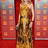 Rosamund Pike brought a ray of sunshine to proceedings in an Alexander McQueen maxi.