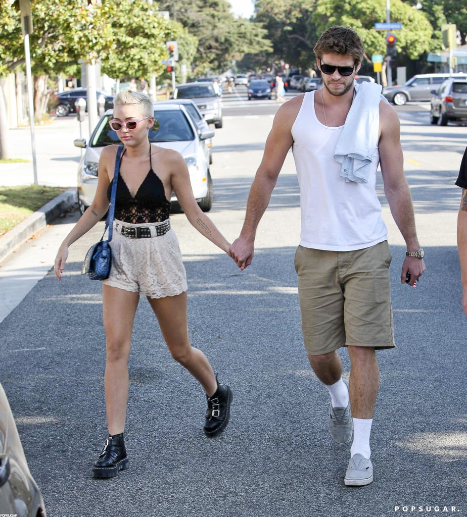 Miley Cyrus and Liam Hemsworth held hands after stopping by a juice store in Santa Monica, CA, on Saturday. The engaged couple are back together in LA following a busy month of work obligations. Miley traveled to Las Vegas to present at the iHeartRadio Music Festival, while Liam spent time in Atlanta filming Catching Fire. Miley also made headlines when the first pictures of her bikini cameo on Two and a Half Men were released. The episode airs on Oct. 18, and it's just the beginning of Miley's return to the small screen. Miley's in talks to star in a Bonnie & Clyde miniseries that will air on Lifetime.