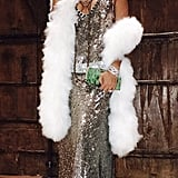 """Jada Pinkett Smith shared a pic of her silver sequined dress and white puffy scarf on Twitter, writing, """"Giving a lil Friday night Josephine Baker:) What a beautiful era. Happy Friday;) J."""""""