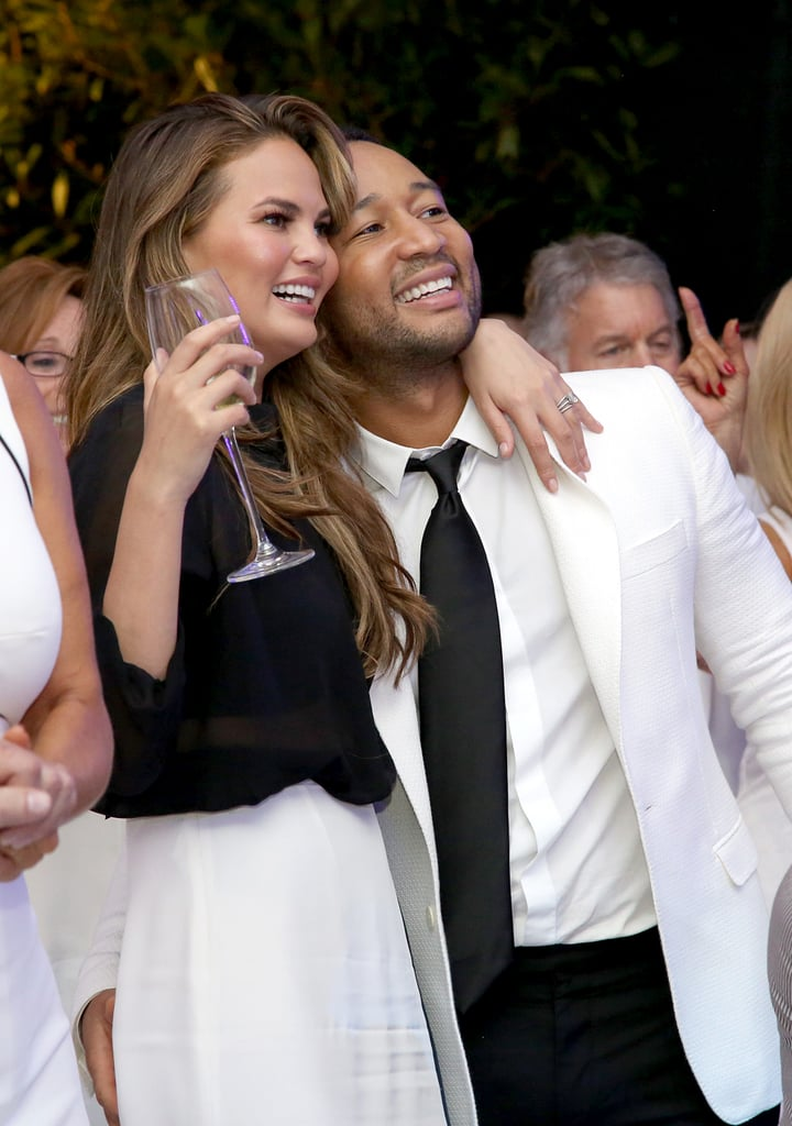 The couple stayed close at a white party dinner in Italy in September 2014.