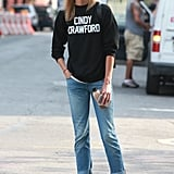 Karlie let her sweatshirt do the talking and styled it simply with a pair of easy jeans and flats for her first day of classes.