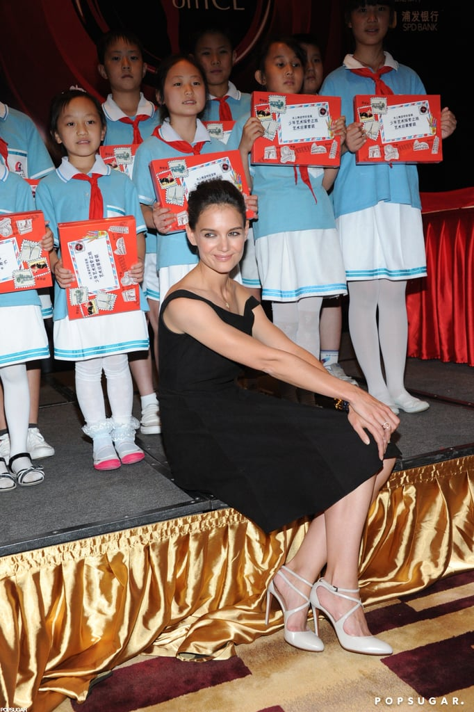 Katie Holmes posed with a group of children at a press conference for Artistry on Ice in Beijing today. She's been in Asia promoting the skating show as an ambassador since last week, when she spoke at an event in Taiwan. While Katie spent the weekend overseas, her husband, Tom Cruise, was busy doing press for Rock of Ages. Tom met up with his costars for the film's fashionable LA premiere Friday before the group traveled to London for another red carpet last night.