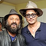 Johnny Depp and artist Dr. Brainwash wore matching caps at the Chateau Marmont.