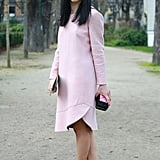 If an early morning meeting means you're pressed for time before leaving the house, simplify your dressing routine by pulling on a classic dress in a fun color that's so chic you won't need any extra embellishments. The bubblegum hue of this long-sleeved style is a statement on its own.