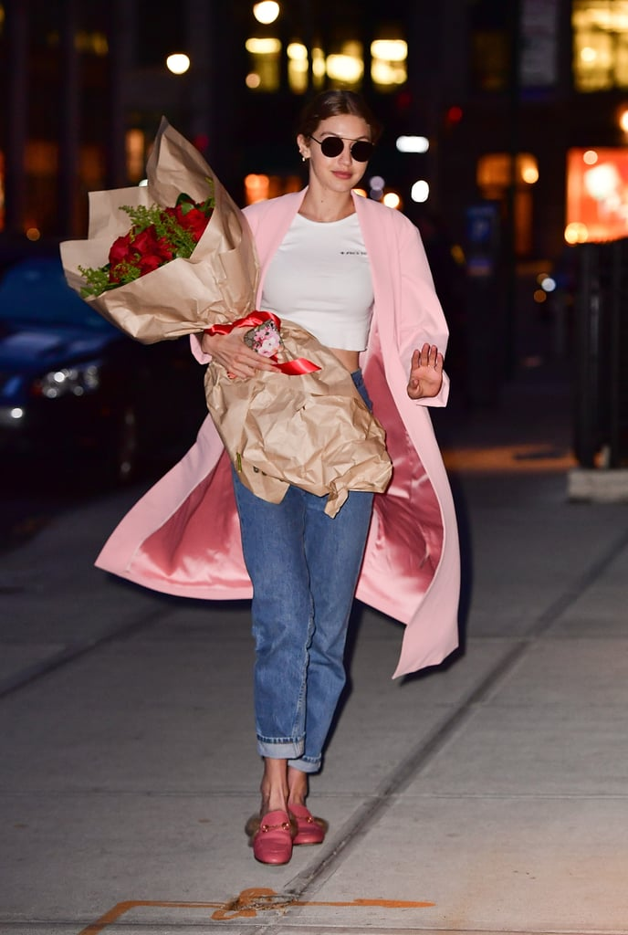 Gigi's casual look has one major thing going for it — aside from that beautiful bouquet. Her coordinating pink duster and Gucci slides give it a sweet color story.