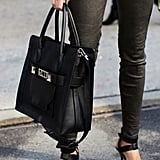 Proenza Schouler's simple black tote added a sleek element to leather pants and subversive ankle-strap pumps.