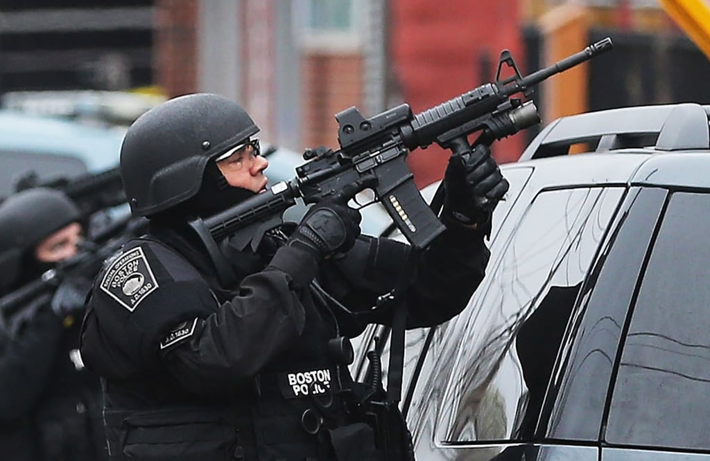 SWAT team members took position during their hunt for the suspect in ...