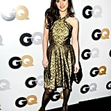 Zooey Deschanel in a gold dress.