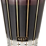 Nest Hearth classic candle ($40), with notes of oud wood, frankincense, and smoky embers.