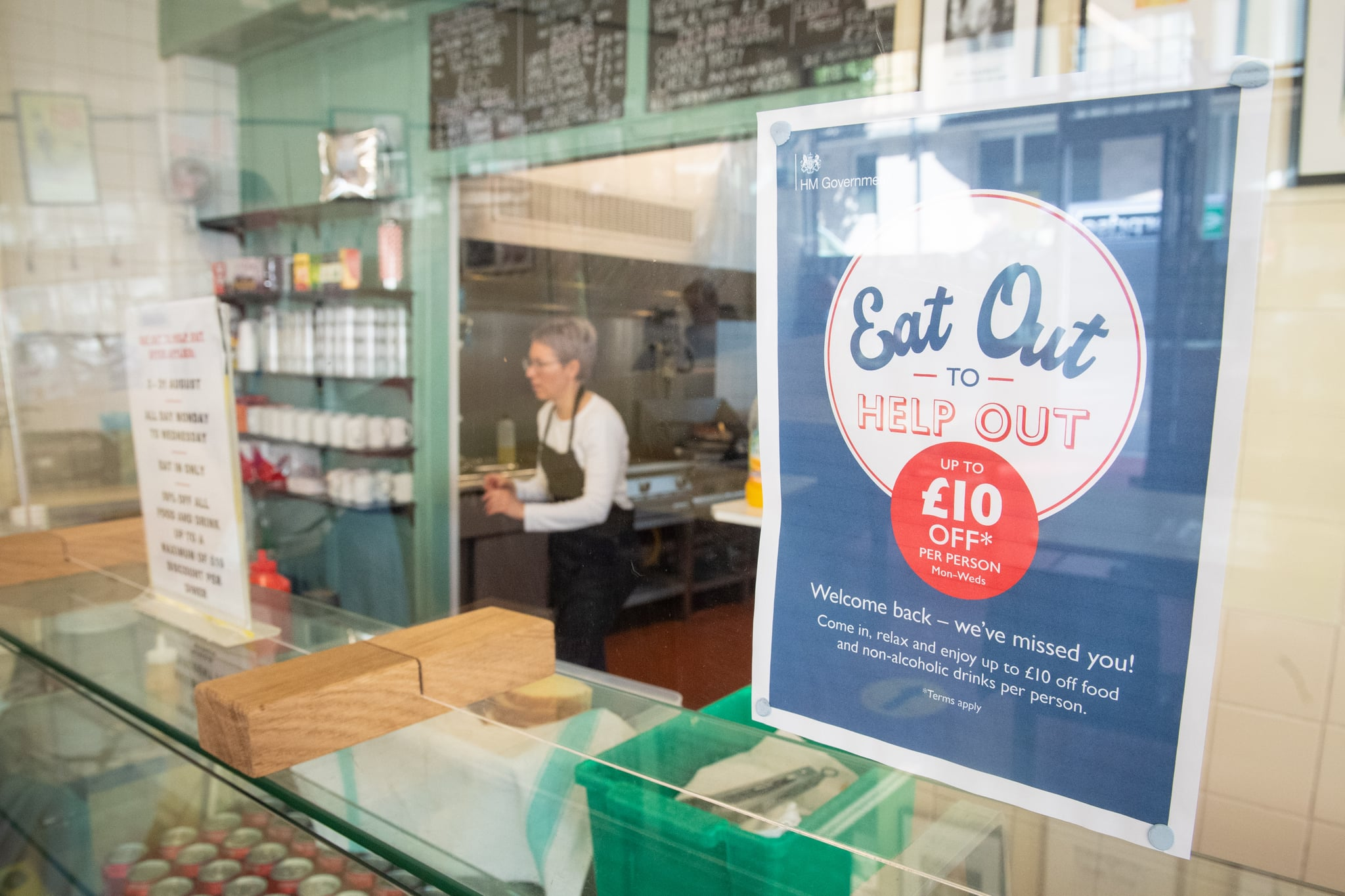 Signage for the 'Eat Out to Help Out' scheme, at the Regency Cafe, in London, one of the participating restaurants where diners will be able to enjoy half-price meals, starting on Monday as the Government kick-starts its August scheme aimed at boosting restaurant and pub trade following the lockdown. (Photo by Dominic Lipinski/PA Images via Getty Images)