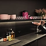 Pink Accents Make the Black Kitchen Surfaces Really Pop