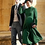 Matching Her Hat With an Emerald Green Dress