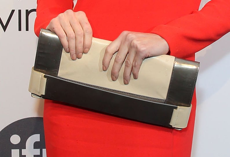 Paz Vega carried a metallic-and-beige colour-blocked clutch.