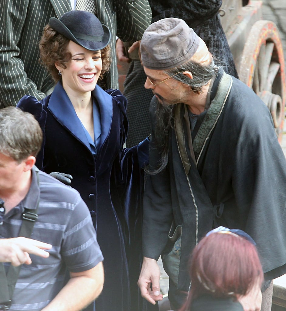 Rachel McAdams laughed between takes on the set of Sherlock Holmes: A Game of Shadows in London today. She was joined by her costar Robert Downey Jr., who was almost unrecognizable in a clever disguise, and the film's director Guy Ritchie. The trio are working on reshoots for their upcoming sequel, due out Dec. 16, though there was no sign of the movie's other leading man, Jude Law. Robert recently wrapped his role as Tony Stark in The Avengers and shared the exciting news that his wife Susan Downey is expecting their first child early next year. Meanwhile RDJ's not the only one expanding his family, Guy became a new dad again on Sept. 5 when his girlfriend Jacqui Ainsley gave birth to a son.