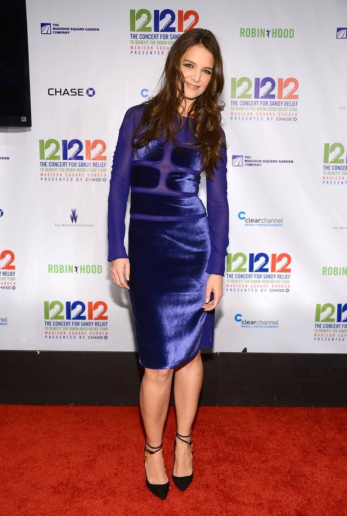 Katie Holmes showed off a bright velvet Tom Ford sheath and ankle-strap pumps.