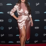 Showing off some leg at the Sports Illustrated Swimsuit Issue event wearing a satin Fleur du Mal trench coat. She finished her look off with patent leather heels by Schutz and jewels by Jennifer Meyer.