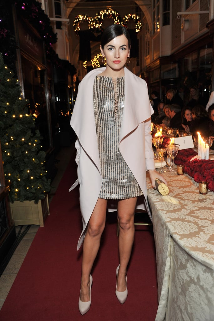 Camilla Belle showed off a pitch-perfect party look in the form of a sequined Salvatore Ferragamo minidress that she topped with a drapey wool coat.