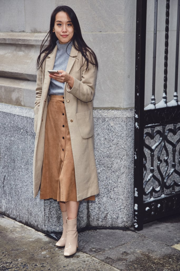On Assistant Editor Marina Liao: Topshop coat, ASOS sweater, and Aritzia suede skirt