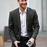 During a visit to Denmark, Prince Harry wore a gray blazer, white shirt, and black pants.