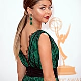 It seems as if Sarah Hyland got a little extension help to add length to her lob for the Emmys. The young star coupled her long ponytail with a lip that was a deep cinnamon shade.