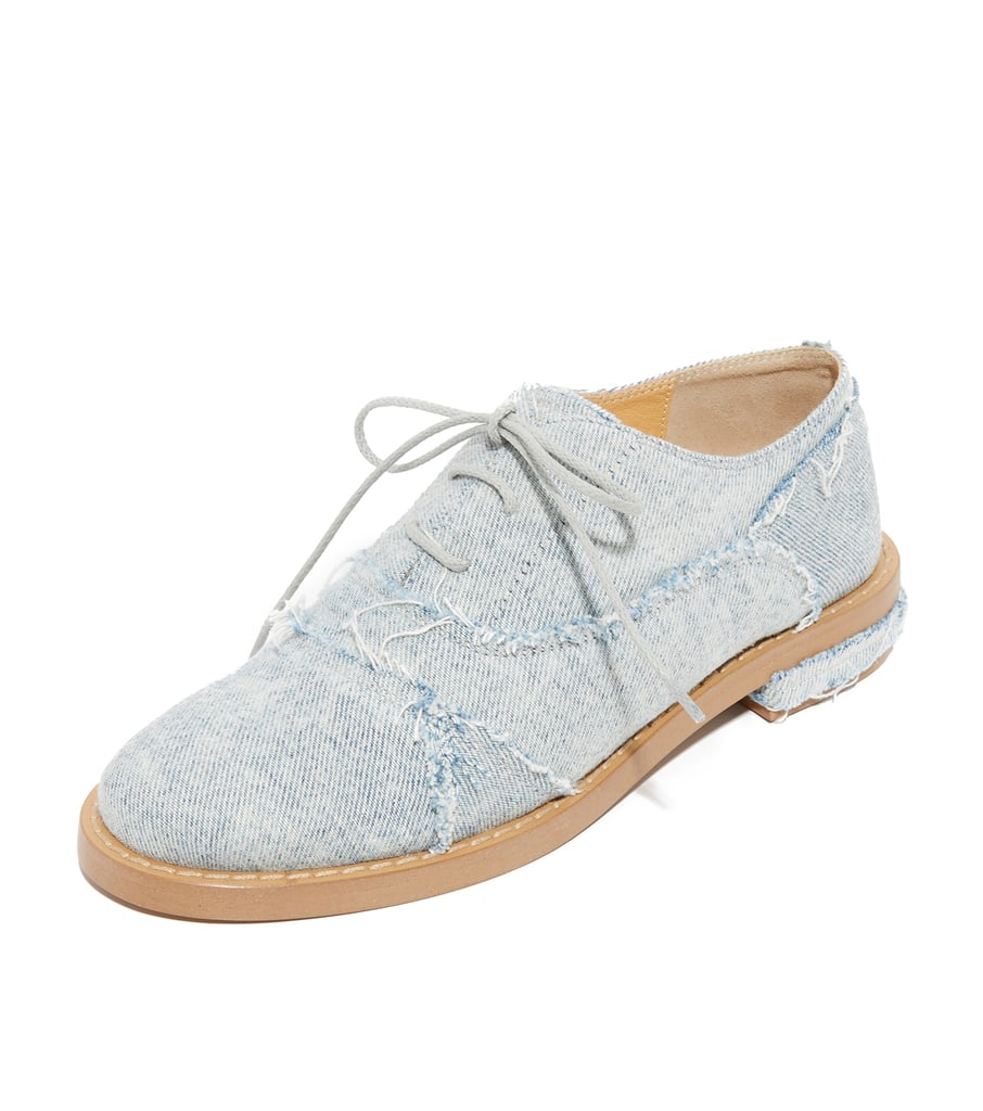 As you give the denim-on-denim trend a try, consider styling these Maison Margiela oxfords ($450) with your outfit. The distressed detail will make a street style statement.