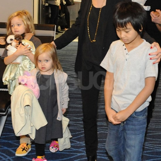 Shiloh, Vivienne, and Maddox Jolie-Pitt walked in the Tokyo airport.