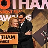 Jacki Weaver hugged David O. Russell on stage.