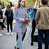 Olivia added interest to this matching set with a button-down layered underneath. Artful layering is a specialty of the style star's, and she put it to work throughout the week in Paris.
