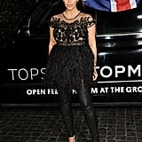 Kim Kardashian donned black on black in a feather-embellished peplum top.