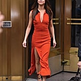 Selena went for a pop of color in this orange Christopher Kane maxi dress, but kept it simple with her black Louis Vuitton heels.