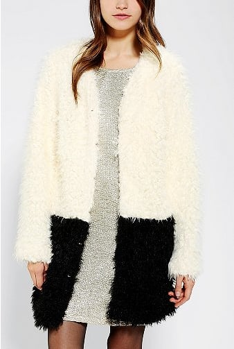 We love the cozy play on white and black — this Minkpink colorblock coat ($119) would look ultrachic over leather pants.