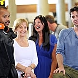 Donald Faison and Zach Braff smiled while waiting for their luggage.