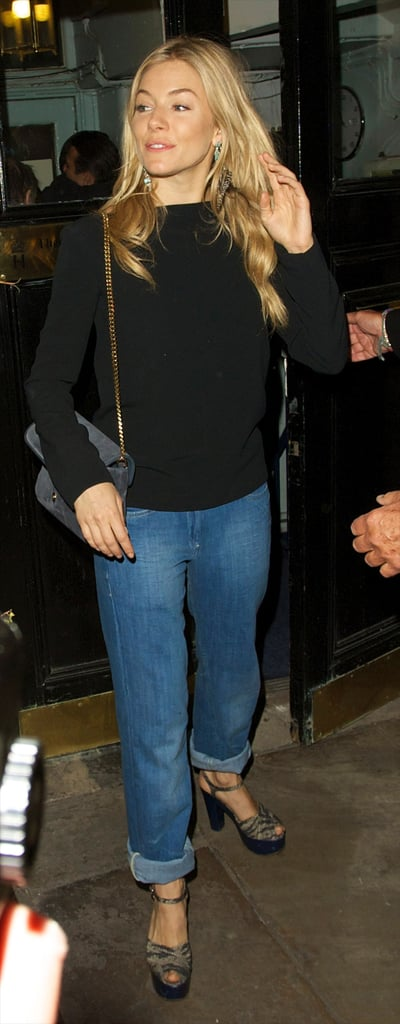 Sienna Miller dressed up her boyfriend-fit denim with a chainstrap bag and heels.