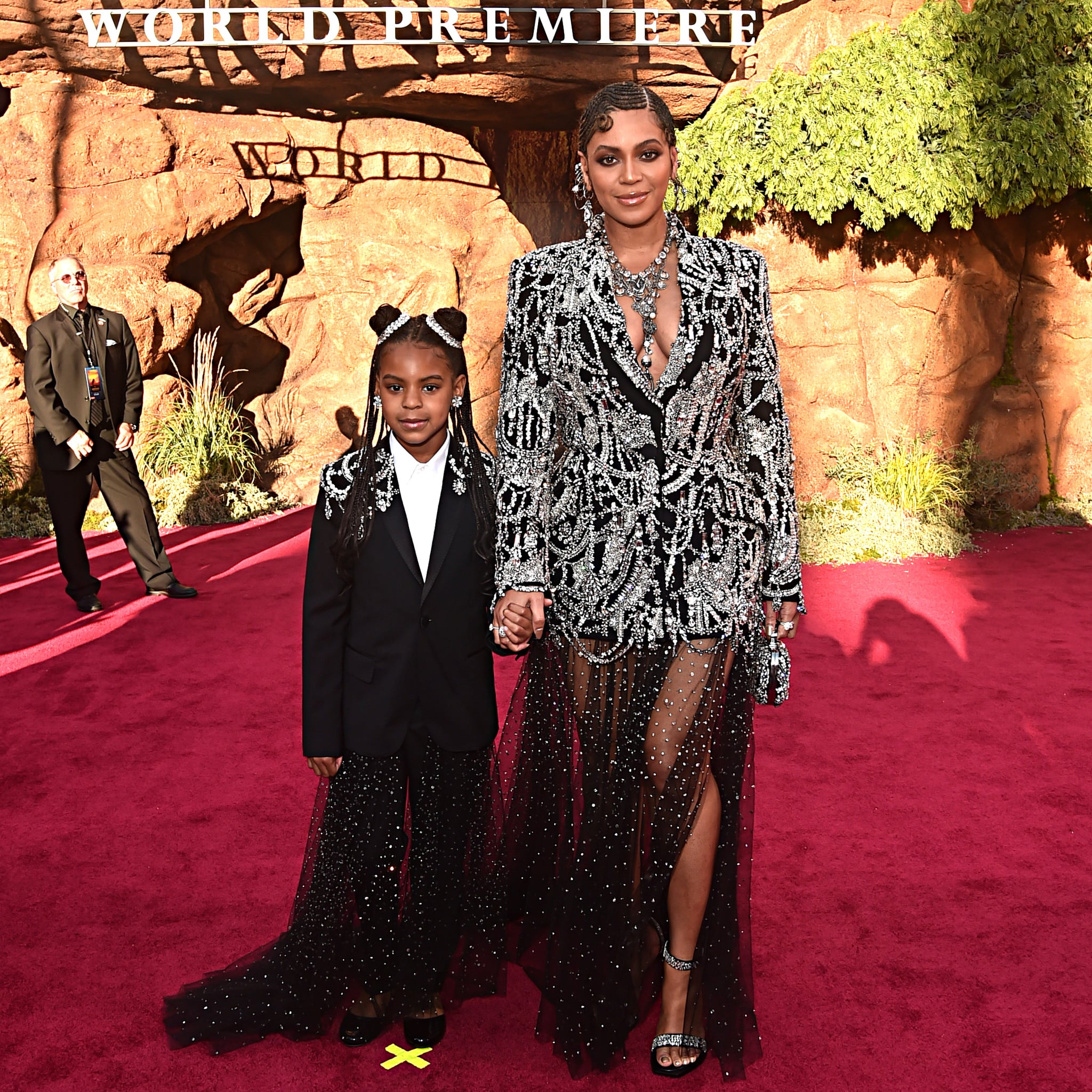 HOLLYWOOD, CALIFORNIA - JULY 09: (EDITORS NOTE: Retransmission with alternate crop.) Blue Ivy Carter (L) and Beyonce Knowles-Carter attend the World Premiere of Disney's