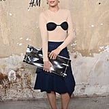 Mena Suvari struck a pose in a Margiela for H&M top paired with a ladylike skirt, but it was her clutch that stole the show.