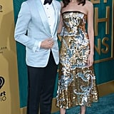 Pictured: Henry Golding and Gemma Chan